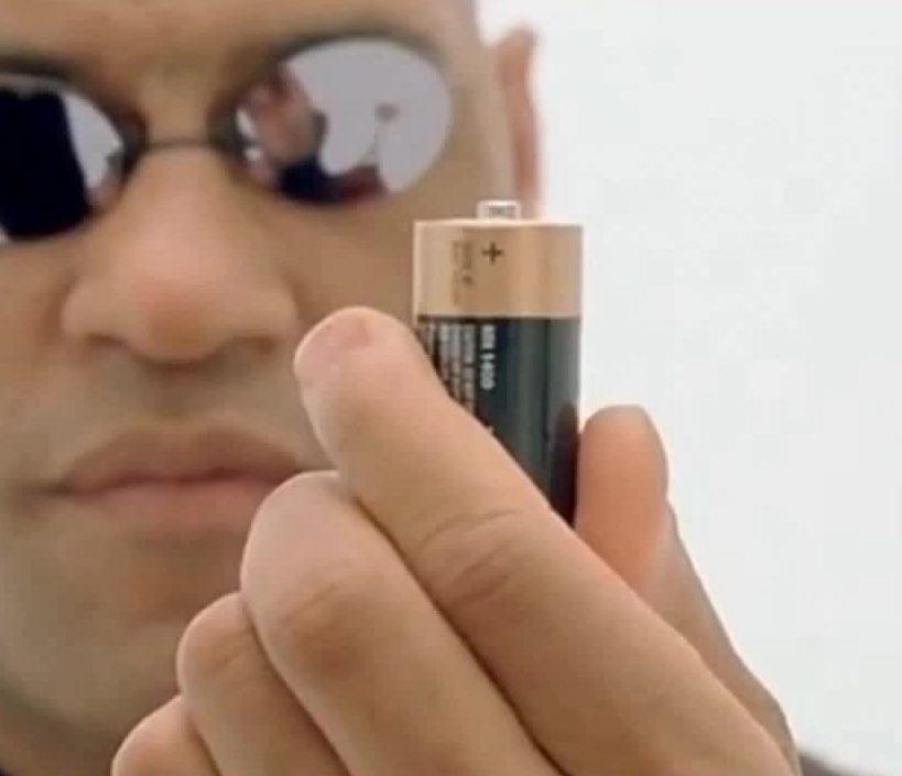 Morpheus holding a battery